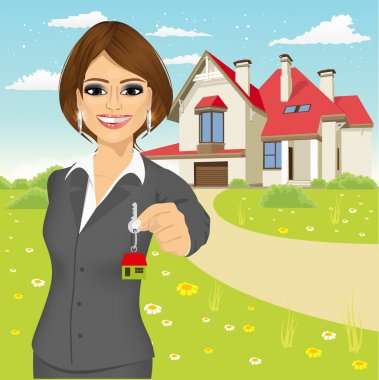 female real estate agent holding the key of a new house