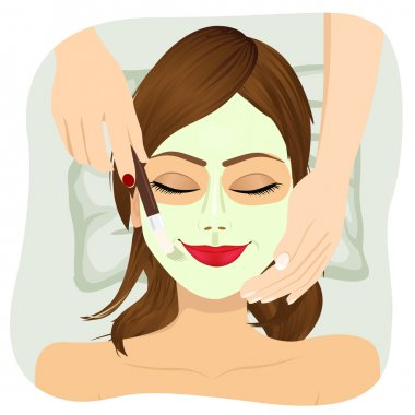 Beautiful woman with cosmetic mask on face