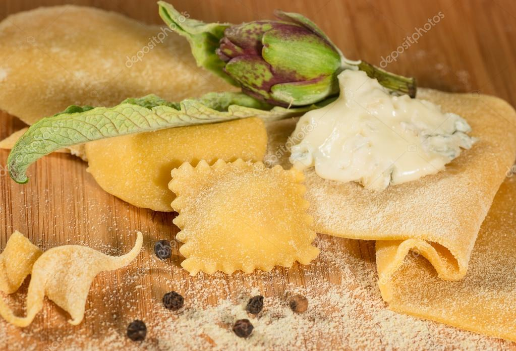 Italian homemade ravioli with gorgonzola cheese, fresh artichoke and a few grains of black pepper.