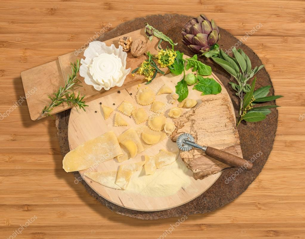 Wide choice of homemade ravioli with fresh cheese,brussels sprouts,artichoke and aromatic herbs paced on a rustic round centerpiece.