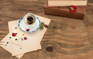 Empty cup with coffee grounds and roses.