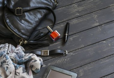 women accessories black leather handbag, scarf, watch, nail Polish and tablet computer
