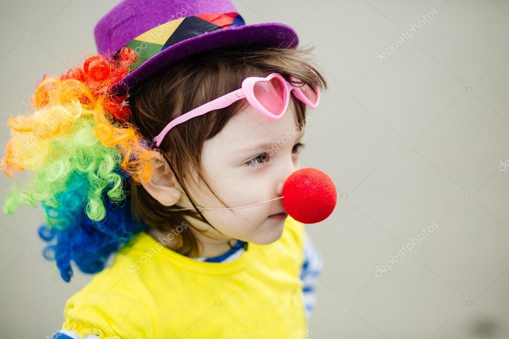 Adorable Little Girl In Clown Costume Outdoors At Summer Day Stock