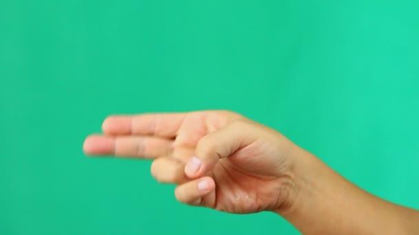 Fegyver jel kéz zöld képernyőn, Chiangmai Thaiföld