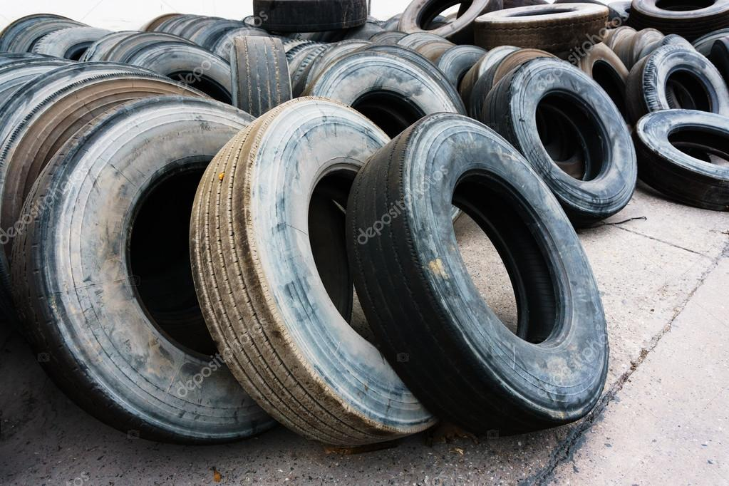 Car Tire Heap Align On Cement Ground Used Tires Stock Photo