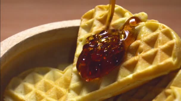 Honey Dripping on Waffles in a Bowl