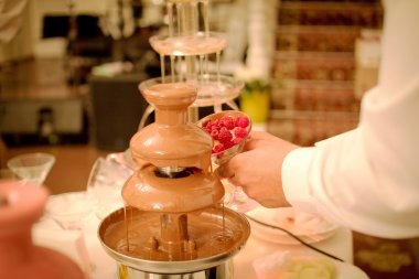 Chocolate fountain placed  in wedding day