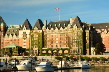 Victoria BC,Canada,July 16th 2015.The iconic Victoria landscape and its bustling inner harbor is always a meeting place for tourists and locals.