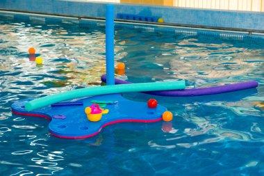 raft, tubes, balls in pool