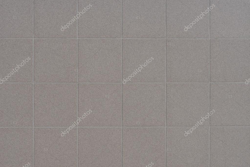 Priorità bassa del muro di piastrelle grigie u foto stock