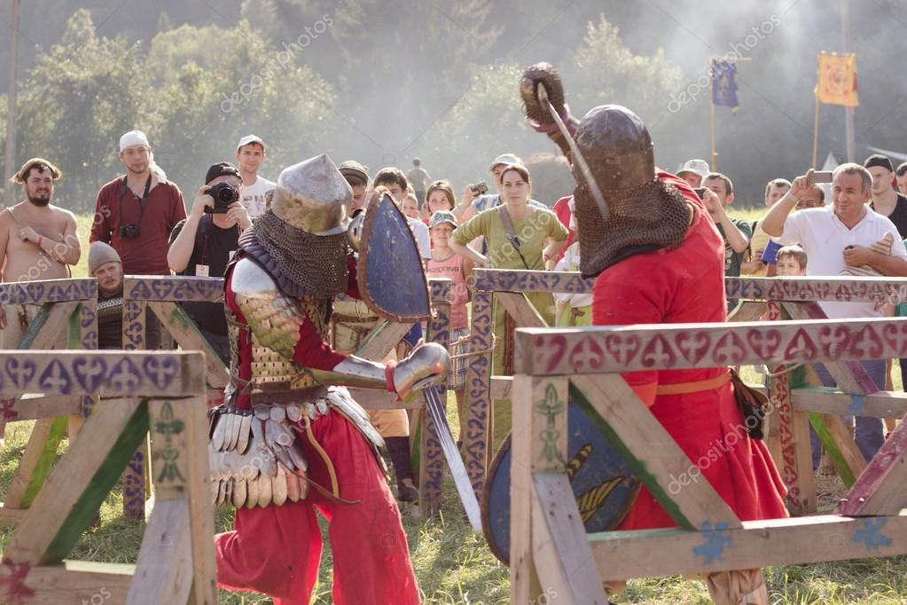 Two knights are fighting at Tustan' festival in Urych, Ukraine, August 2, 2014