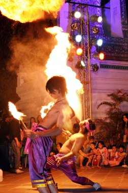 Street entertainers breathing fire