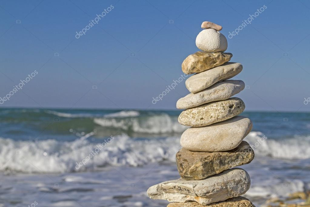 Stone tower in sea surf
