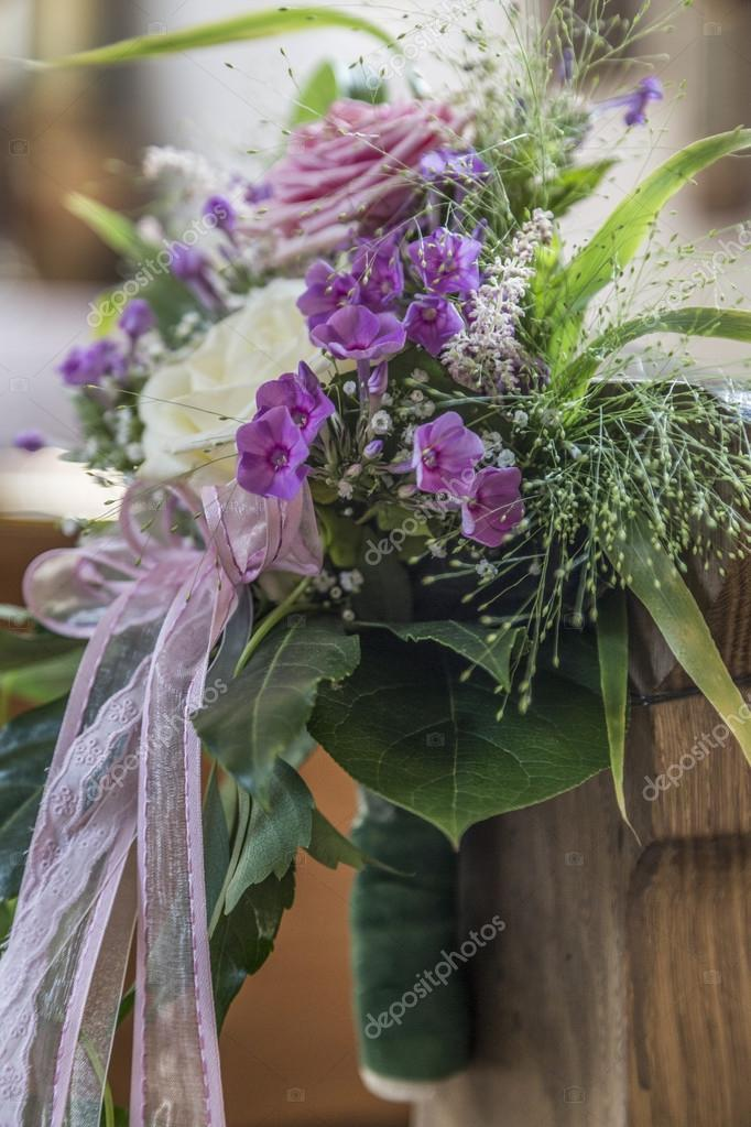 Church pew details with floral wedding decoration stock photo church pew details with floral wedding decoration stock photo junglespirit Choice Image