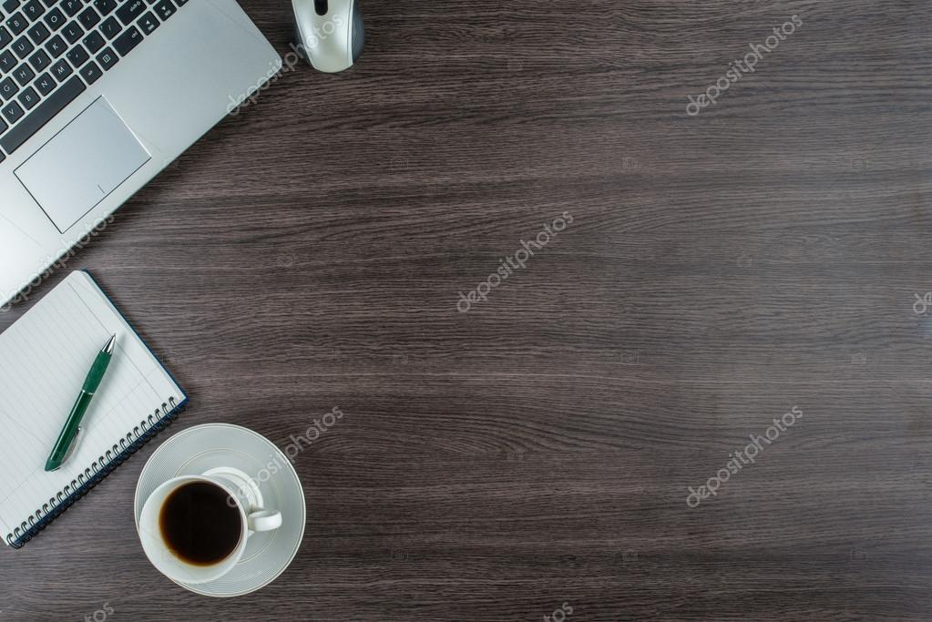 Laptop, notebook and coffee cup on work desk