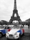 Citroen 2CV under the Eiffel Tower in Paris, France