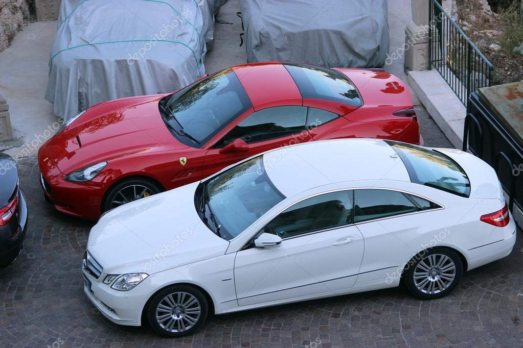 Luxury Cars Parked in a Parking Lot – Stock Editorial Photo © bensib