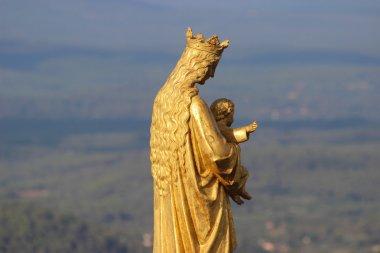 Golden statue of Virgin Mary and Baby Jesus