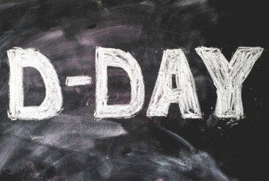 D-day written on black chalkboard