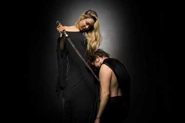 Glamourous blonde lady with her slave