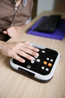 Blind person using audio book player for visually impaired