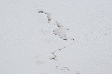 Cracked peeling layer on ceiling