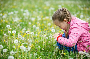 Little girl photographing with her smart phone