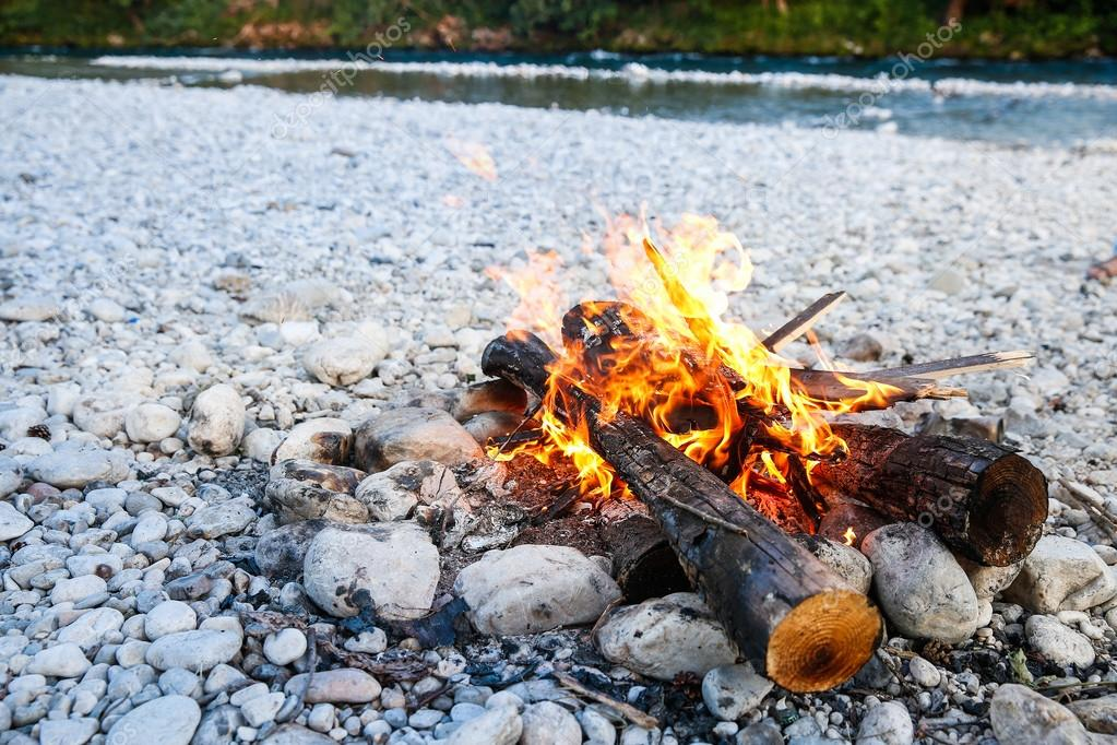 Self-made campfire by the mountain river