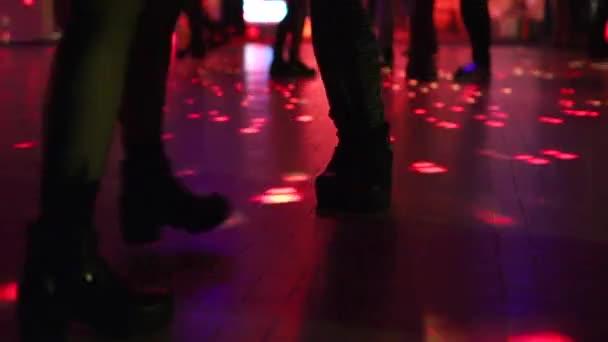 two women dancing in disco