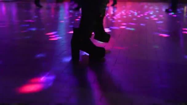 boots dancing in disco