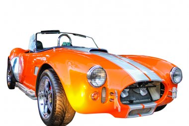 The AC Cobra, sold as the Ford Shelby AC Cobra 427 in the United States on white background.