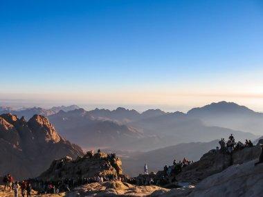 Pilgrims on Mount Sinai at sunrise