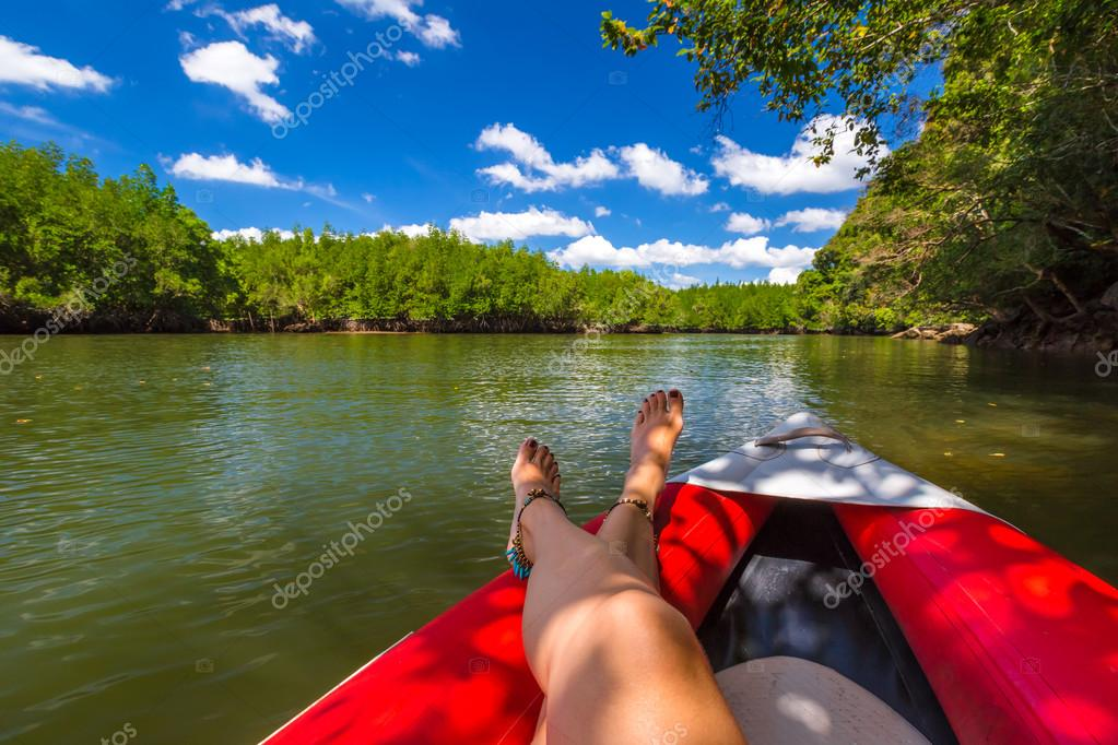 Tanned legs on kayak