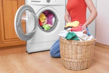 Woman and a washing machine.