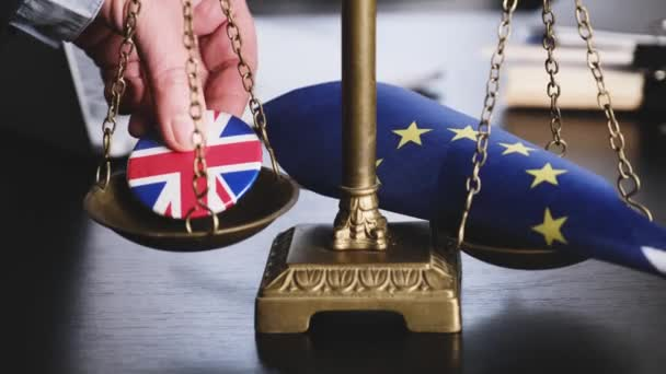 Lawyer Puts on the Scales European Union Flag and Great Britain Flag on a Jacket Icon Together on a Scales.