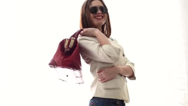 smiling woman with a red handbag