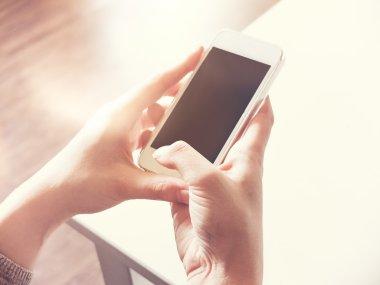 using white smartphone