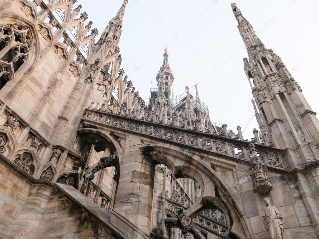 Low Angle Architectural Detail Of Italian Gothic Flying Buttresses And Spires Historic Milan Cathedral Church Dedicated To St Mary The Nativity