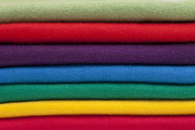 A stack of shirts in bright colours