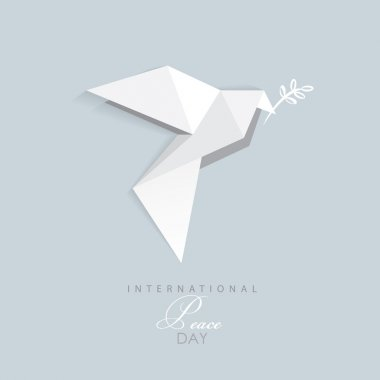 White origami dove with olive branch