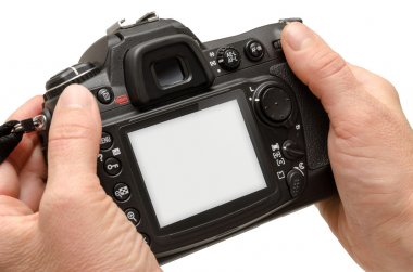 Isolated camera in hands. Isolated white screen for mockup.