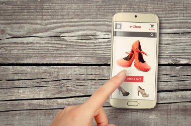online shopping with smart phone on table