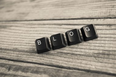 BLOG wrote with keyboard keys on wooden background