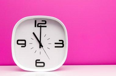 White modern clock on light blue background