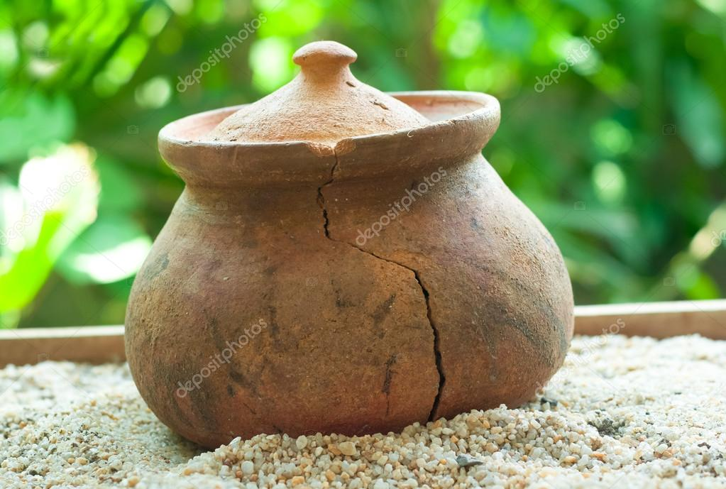 broken Clay pots or porttery on a white sand outside kitchen roo