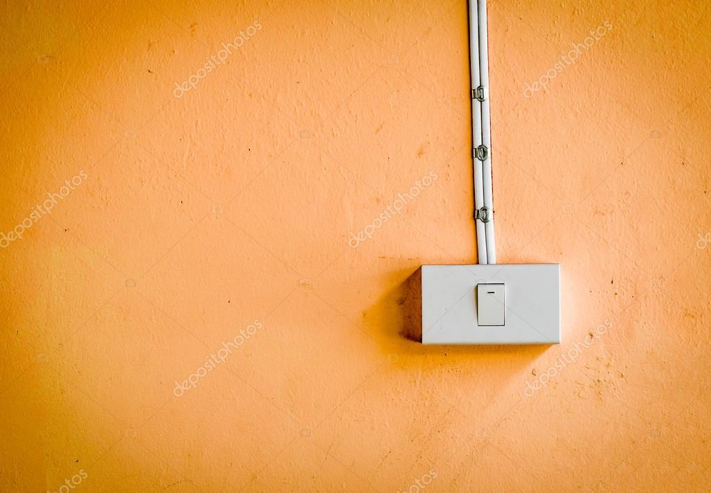 Pareti Colore Arancione : Interruttore sulla parete di colore arancione u2014 foto stock