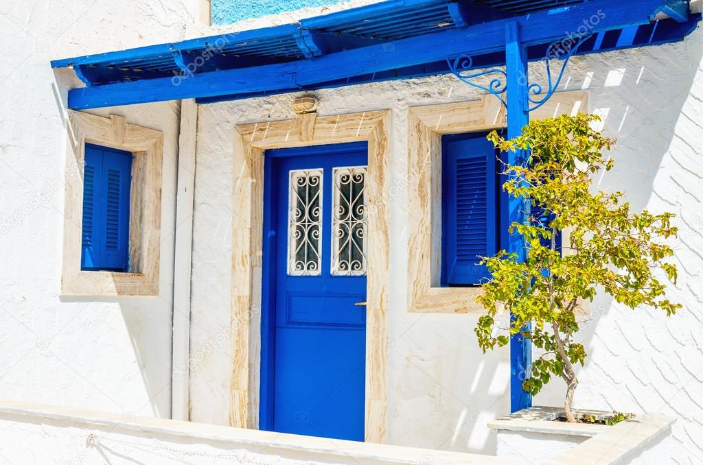 Wooden blue doors and windows typical for Greece