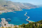 Fotografie Blick auf Kai, Wellenbrecher und Hafen der griechischen Insel