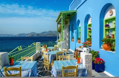 Typical colorful Greek restaurant in Greece