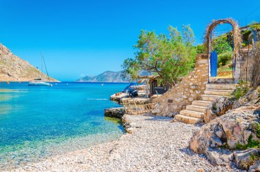 Stairs from sandy beach on Greece island Kalymnos